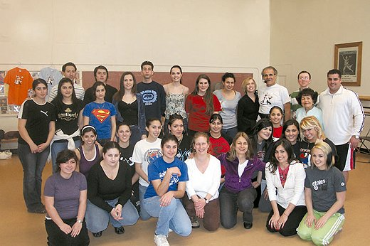 Tom Bozigian, standing, fourth from right, with students. Photo: Barlow Der Mugrdechian
