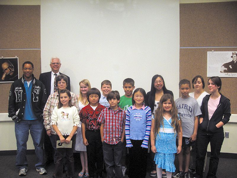 William Saroyan Society President John Kallenberg, standing, second from left, with winners of the William Saroyan Society Writing Contest at the Woodward Park Library.