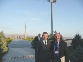 Armenian Genocide Museum director Dr. Hayk Demoyan, left, with Barlow Der Mugrdechian, at the Armenian Martyrs Monument.