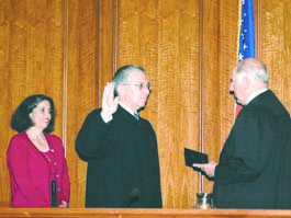 Justice Poochigian, center, being sworn into office by Chief Justice Ronald George, with Poochigian's wife, Fresno County Supervisor Debbie Poochigian witnessing the event.
