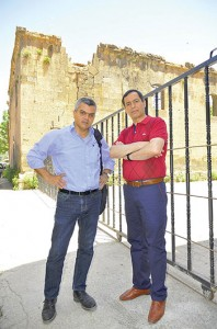 Ara Sarafian, left, and co-mayor Hüseyin Olan in front of the old Armenian Protestant church in Bitlis.