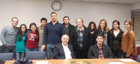 Dr. Ara Sanjian, standing, fifth from right, with members of the Armenian Students Organization before his Dec. 4 lecture.