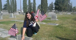 Marina Chardukian placing American flags on the graves of Veterans at Ararat Armenian Cemetery in Fresno Photo: ASP Archive