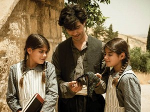 "Nazaret Manoogian (Tahar Rahim) with his two daughters from the movie ""The Cut."""