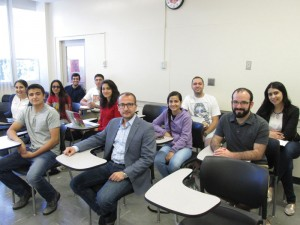 Dr. Khatchig Mouradian, seated center, with students from his Armenian Genocide class. Photo: Barlow Der Mugrdechian
