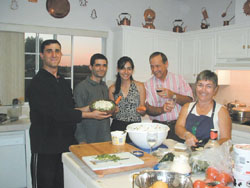 Left to right: Tigran Khachatryan, Armen Kakosyan, Zaruhi Muradyan, Dr. Robert and Pam Wample at the Wample home, preparing for an Armenian style dinner.