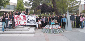 Students gather at the Free Speech area on the Fresno State campus to commemorate the 90th anniversary of the Armenian Genocide.  On the right is the model of the Genocide Monument.