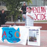 Student Gary Kerboyan reciting an Armenian poem by Siamanto.