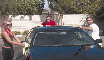 L. to R: Stephanie Cassidy, Hagop Ohanessian, and Stepan Kyutunyan at the AS carwash.